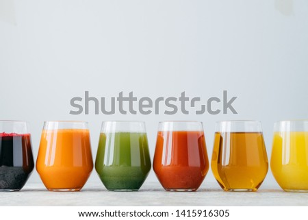 Assortment of jars with tasty multicolored juice, stand on table against white background. Non alcoh Stock photo © vkstudio