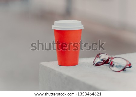 Horizontal shot of red coffee to go and optical glasses. Aromatic coffee for you to drink. Drinking  Stock photo © vkstudio
