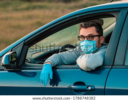Protected driver in car wearing mask and gloves gesturing with t Stock photo © simazoran