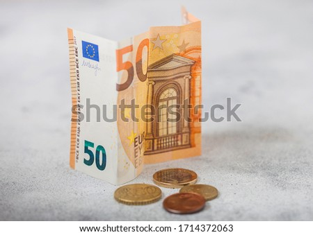 Fifty euro banknote with coins on light background. Economy crisis concept. Stock photo © DenisMArt