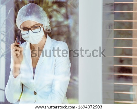 Potrait of a member of medical staff making a phone call during  Stock photo © majdansky