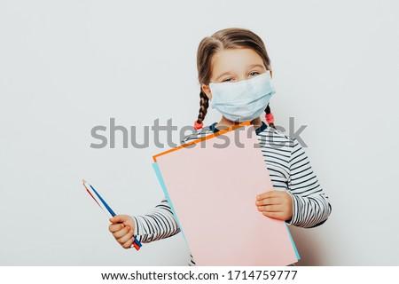 Little girl, child in mask sits on windows, coronavirus quarantine Stock photo © Illia