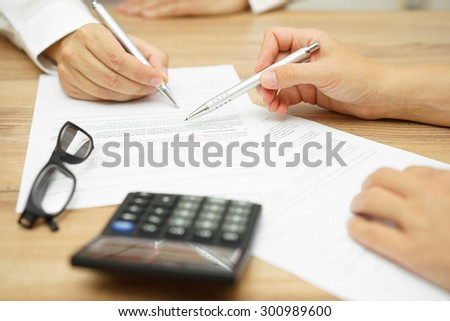 Lawyer working with client discussing contract papers with brass Stock photo © snowing