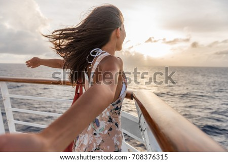 Happy carefree freedom woman in front of cruise ship. Caribbean luxury travel vacation concept. Stock photo © Maridav