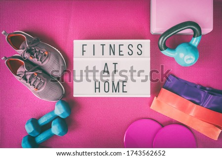 Fitness at home sign with pink yoga mat, running shoes, kettlebell weight and dumbells resistance ba Stock photo © Maridav