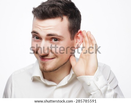 Young business man listening something isolated on white backgro Stock photo © dacasdo