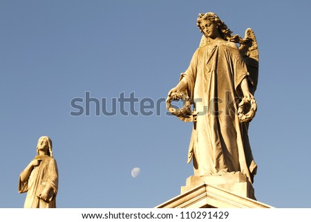 statue in the cemetery of recoleta with the moon in the backgrou stock photo © spectral
