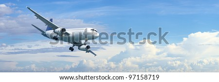 jet plane in a blue cloudy sky is maneuvering for landing panor stock photo © moses