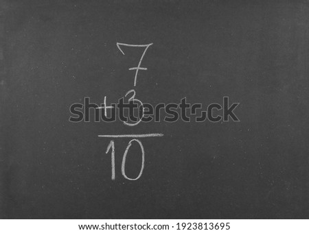 Chalkboard with an addition and a result written on it isolated against a white background Stock photo © wavebreak_media