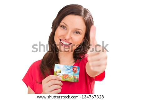Extremely positive woman holding bank plastic credit or debit ca Stock photo © HASLOO