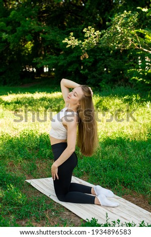 Aerobics spinning woman stretching exercises after workout  Stock photo © lunamarina