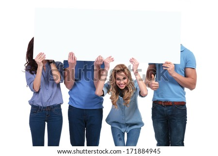 casual friends presenting a blank board and making the ok sign stock photo © feedough