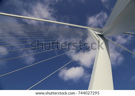 detail of erasmus bridge with blue sky in rotterdam the netherl stock photo © anmalkov