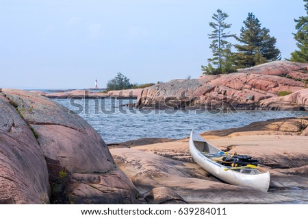 Trees in sea with boats in the background, Georgian Bay, Tobermo Stock photo © bmonteny