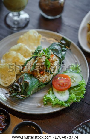 grilled sandwich with some basil and tomatoes in the background stock photo © phila54