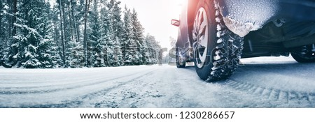 Snowy winter road with cars driving Stock photo © smuki