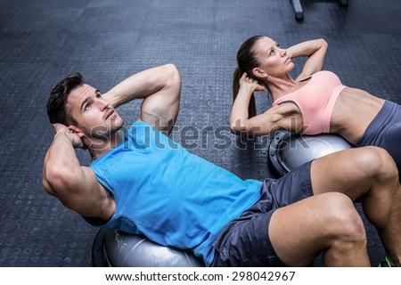 athletic attractive couple   man and woman doing fitness exercis stock photo © vlad_star
