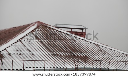 White house with red roof and chimne in cloudy. Background sun shines brightly stock photo © cherezoff