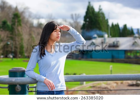 Young teen girl standing, leaning against railing at park shadin Stock photo © jarenwicklund
