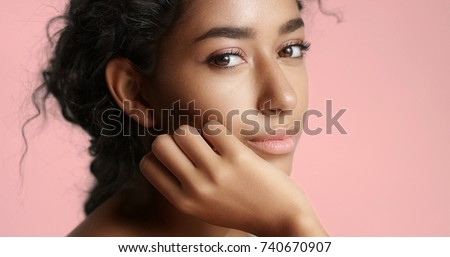 Portrait of beautiful girl stroking her face with healthy skin  Stock photo © master1305