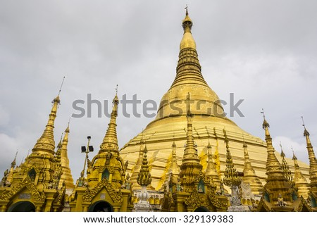 Shwedagon Pagoda in Rangoon with temple covered with foil gold Stock photo © meinzahn