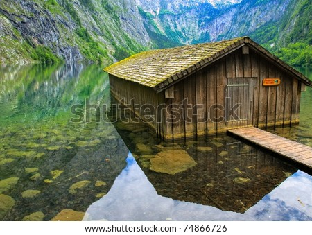 Fisherman's house on Konigsee lake in the Alps mountains, German Stock photo © Xantana