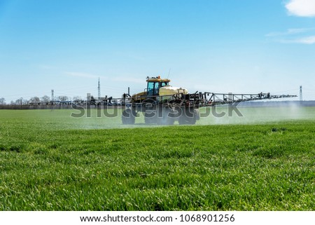 Agricultural tractor with crop sprayer in cultivated corn crop f Stock photo © stevanovicigor