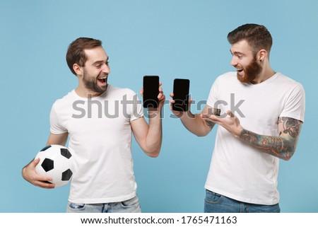jóképű · férfi · tart · futballabda · fehér · sportos · férfi - stock fotó © master1305