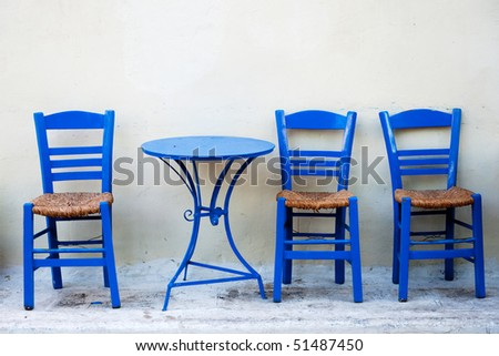 Traditional chairs with a table of a traditional tavern at the beautiful Greek village of Marathopol Stock photo © ankarb