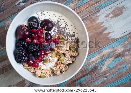 Fresh cherry yogurt with oats and chia seeds, healthy breakfast Stock photo © yelenayemchuk