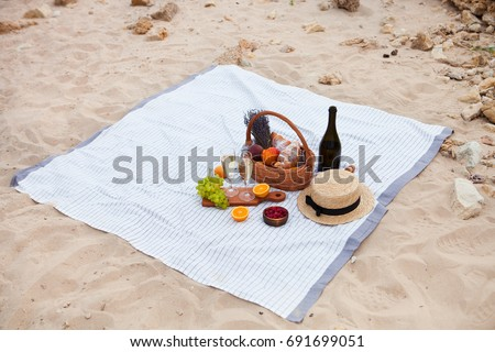 picnic on the beach at sunset in the white plaid food and drink stock photo © yatsenko