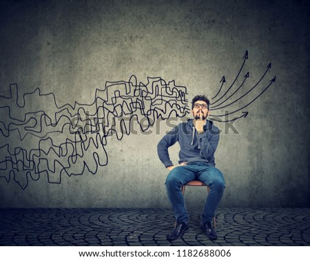 man brainstorming getting his thoughts together planning making conclusions Stock photo © ichiosea