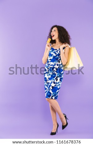 full length portrait of lucky charming woman 20s wearing dress h stock photo © deandrobot