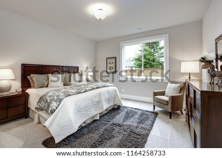 light modern master bedroom interior with darkwood bed and dress stock photo © iriana88w