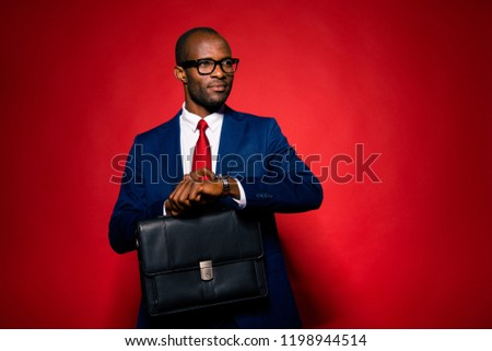 confident businessman in black suit smiling and waiting in line stock photo © feedough