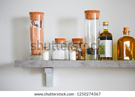 Selective focus of arranged jars with various spices and olive o Stock photo © dashapetrenko
