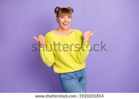 Portrait of funny young girl with two buns pointing finger upwar Stock photo © deandrobot