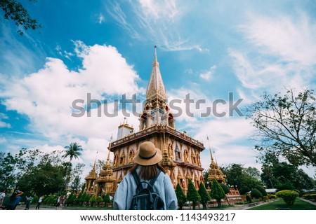 Young woman tourist in Thai temple in Phuket Town Wat Mongkolnimit Stock photo © galitskaya