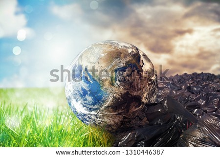 Stock photo: Earth is chancing due to pollution and undifferentiated trash. Save the World. World provided by NAS
