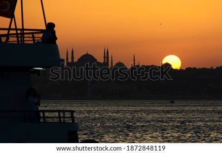 istanbul night cityscape with looking over golden horn to suleymaniye mosque on a twilight dramatic stock photo © artjazz