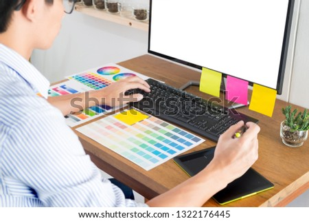 graphic designer or creative holding mouse and do his work mater stock photo © snowing