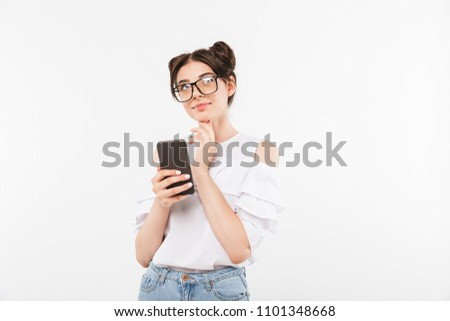 photo of dreaming woman with double buns hairstyle looking upwar stock photo © deandrobot