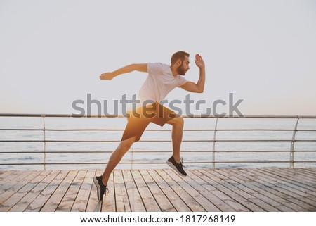 Kép sportos sportos férfi 20-as évek rövidnadrág Stock fotó © deandrobot