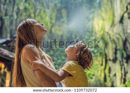 Mom and son in the background of Batu Caves, near Kuala Lumpur, Malaysia. Traveling with children co Stockfoto © galitskaya