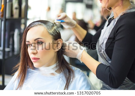 Professional female hairdresser applying color to female custome Stock photo © dashapetrenko