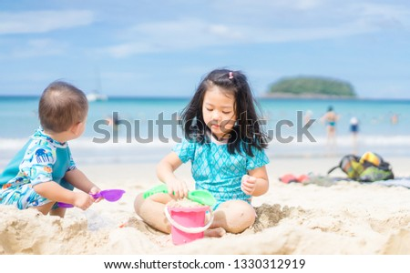 happy baby girl and her sisters playing in sand on a beautiful b stock photo © dashapetrenko