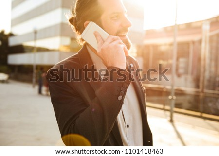 Closeup photo of sunlit businesslike man in suit smiling, while  Stock photo © deandrobot