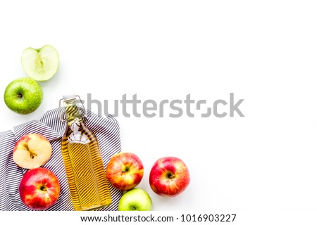 Glass of homemade organic apple cider with fresh apples in box on wooden background. Space for text Stock photo © DenisMArt