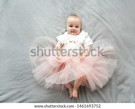 Adorable funny baby girl wearing tu-tu skirt on the bed. Close u Stock photo © dashapetrenko