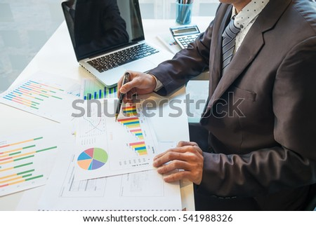 businessman working plan the business and analysis many chart gr stock photo © Freedomz